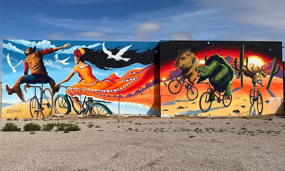 Large mural by Joe Pagac - people and animals riding bicycles
