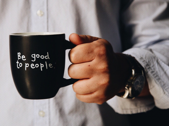 "Coffee mug with the words ""Be Good to People"" - Employee advising"