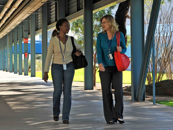 Two employees walking down a hallway at Tech Parks Arizona