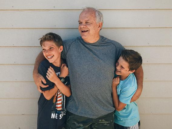Happy grandfather with grandsons - Disability and Life Insurance