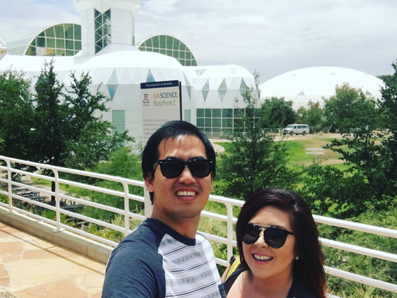 Smiling couple in front of Biosphere 2