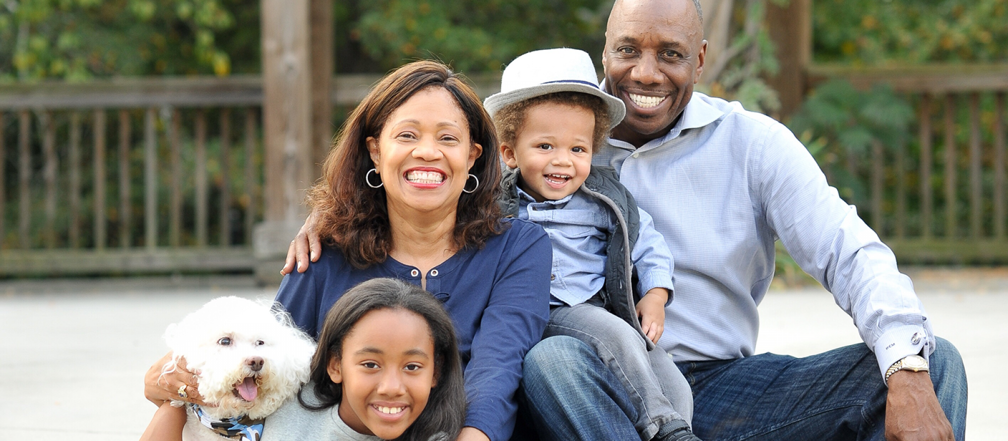 Portrait of smiling family - compensation and benefits