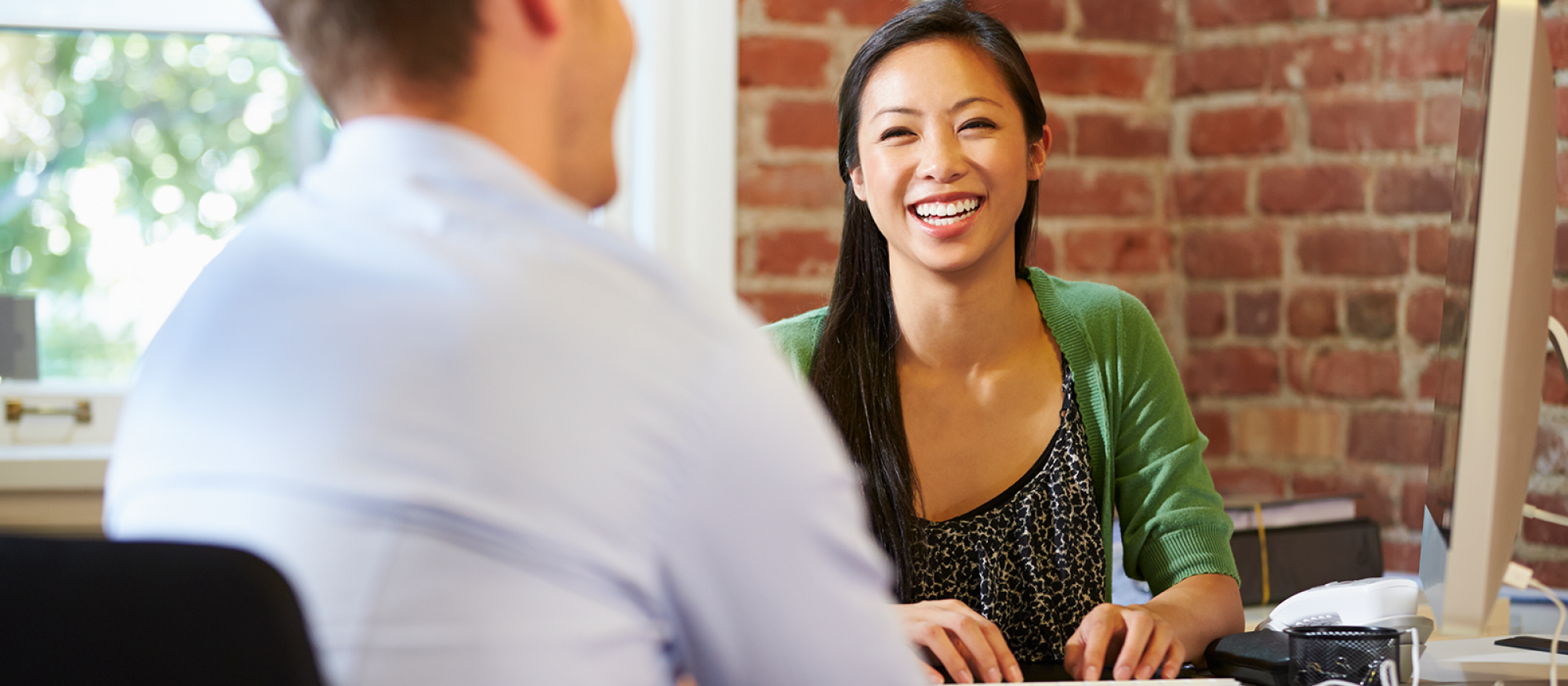 Smiling hiring manager meeting with an applicant